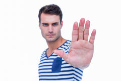 Handsome hipster showing stop sign with hand Royalty Free Stock Image