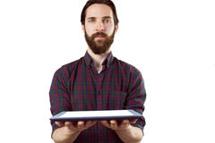 Handsome hipster showing tablet pc Stock Photography