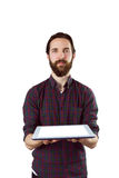 Handsome hipster showing tablet pc Royalty Free Stock Images