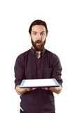 Handsome hipster showing tablet pc Royalty Free Stock Photography