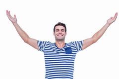 Handsome hipster smiling at camera with arms outstretched Royalty Free Stock Photography