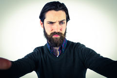 Handsome hipster taking a selfie royalty free stock photo