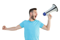Handsome hipster talking through megaphone Royalty Free Stock Photography