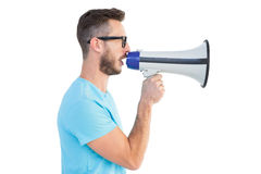 Handsome hipster talking through megaphone Royalty Free Stock Images