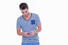 Handsome hipster texting on smartphone Royalty Free Stock Photo