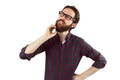 Handsome hipster thinking and scratching beard Royalty Free Stock Photos