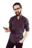 Handsome hipster using his phone. On white background Royalty Free Stock Photos