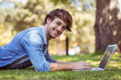 handsome hipster using laptop in park Stock Photo