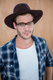 Handsome hipster wearing nerd glasses and hat Stock Photos