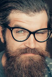 Handsome hipster winks his eye Stock Images