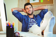 Handsome hipster working at desk Stock Photos