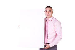Handsome Hispanic Businessman Holding a Blank Sign Royalty Free Stock Photography
