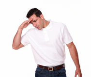 Handsome hispanic guy with head pain Stock Photo