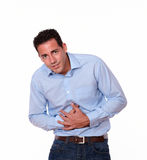 Handsome hispanic guy with stomach pain Stock Photography