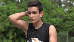 Confused Athletic Male Hispanic Teenager. A handsome hispanic male teen stock video footage