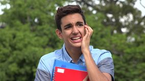 Confused Male Hispanic Student Teenager. A handsome hispanic male teen stock video footage