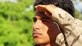 Good Looking Male Soldier Saluting. A handsome hispanic male teen Stock Image