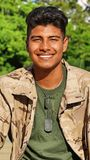 Hispanic Male Soldier Smiling. A handsome hispanic male teen Royalty Free Stock Images