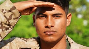 Latino Male Soldier Saluting. A handsome hispanic male teen Stock Images
