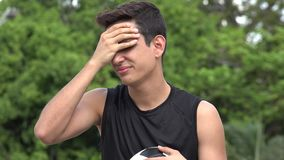 Losing Athletic Male Hispanic Teenager. A handsome hispanic male teen stock video footage