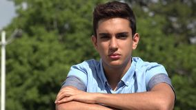 Serious Male Hispanic Teenager. A handsome hispanic male teen stock video