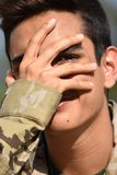 Male Soldier Under Stress. A handsome hispanic male teen Royalty Free Stock Photo