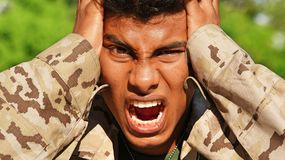 Male Soldier Under Stress. A handsome hispanic male teen Royalty Free Stock Images
