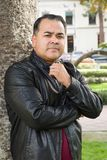 Handsome Hispanic Man in a Black Leather Jacket. Headshot Portrait of Handsom Hispanic Man royalty free stock images