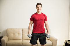 Handsome Hispanic man lifting weights Royalty Free Stock Photography