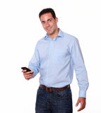 Handsome hispanic man sending a message Royalty Free Stock Photography