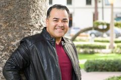 Portrait of Handsome Hispanic Man. Handsome Hispanic Man wearing a Black Leather Jacket Outdoors royalty free stock photo