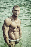 Handsome, hot young bodybuilder in the sea Stock Photos