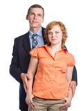 A handsome husband embraces his attractive wife Stock Images