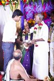 Handsome Indian groom dressed in traditional blue suit during the ceremony, with his family and the brahman, just before meeting h. PONDICHERY, PUDUCHERY, TAMIL Royalty Free Stock Images