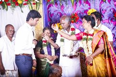 Handsome Indian groom dressed in traditional blue suit during the ceremony, with his family and the brahman, just before meeting h. PONDICHERY, PUDUCHERY, TAMIL Royalty Free Stock Photography