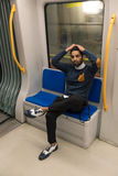 Handsome Indian man posing in a metro car Royalty Free Stock Photography