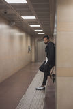 Handsome Indian man posing in a metro station Royalty Free Stock Photo