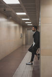 Handsome Indian man posing in a metro station Stock Photo