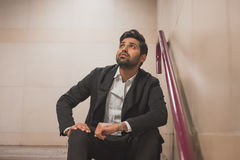 Handsome Indian man posing in a metro station Royalty Free Stock Photos