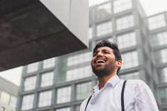 Handsome Indian man posing in an urban context Stock Photo