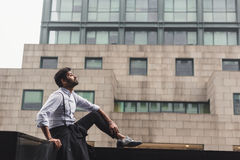 Handsome Indian man posing in an urban context Royalty Free Stock Photos