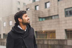 Handsome Indian man posing in an urban context Royalty Free Stock Photo