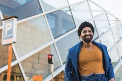 Young Indian man posing in an urban context Stock Photos