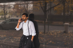 Handsome Indian man talking on phone Stock Images