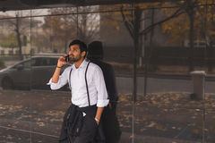Handsome Indian man talking on phone Stock Photos