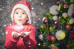 Handsome inspired boy holding a snowflake, winter season, snow Stock Photos