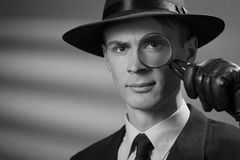 Handsome intelligent young detective in a hat Stock Image