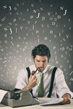 Handsome journalist surrounded by words Stock Photography