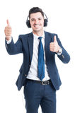 Handsome joyful lawyer listening music and doing double thumbup. Gesture acting confident isolated on white background Royalty Free Stock Images