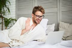Free Handsome Joyful Male Chatting With Dearest In Net Royalty Free Stock Photo - 120275415